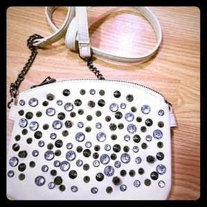 Under One Sky rhinestones and spikes purse